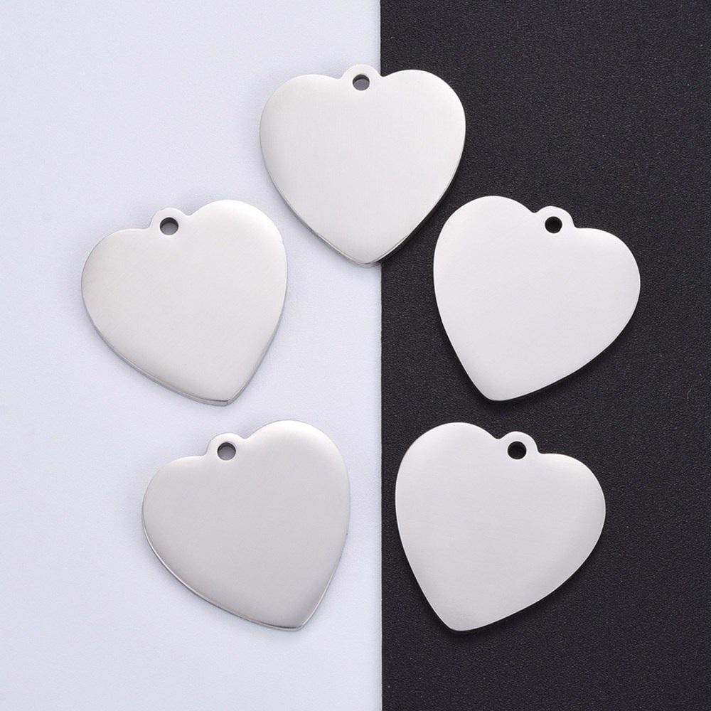PERSONALIZABLE. PREMIUM Colgante corazón acero inoxidable 304. Tamaño 33x33x1.7mm. Agujero 2,7mm