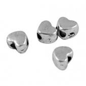 (10Grs - 95unid. aprox) Abalorios metálicos corazones aleación de metal color plata vieja  3,5mm. Agujero 1mm.