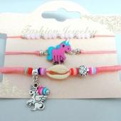 Conjunto de 3 pulseras ajustables de hilo rosa con adorno en metal unicornio