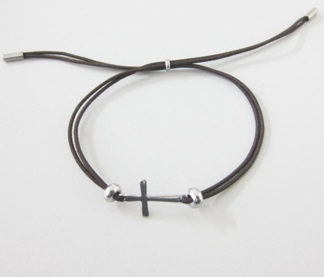 Kit de montaje. Pulsera ajustable de hilo elastico marrón 1mm con piezas de acero inoxidable.