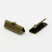 100 unidades.Terminal metal  color bronce 20x8x5mm, agujero 2mm
