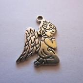 Colgante niña angel plata vieja 24x20mm.