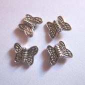 Abalorio mariposa plata vieja 10x8mm. Interior 1mm