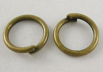 Argollitas bronce antiguo 5mm x 0,8mm. - 20 GR. (Aprox. 420 unidades)