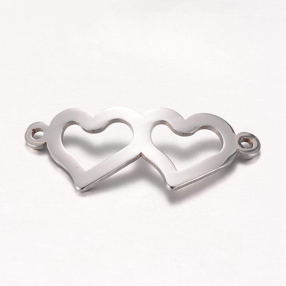 Conector acero inoxidable corazones. 31.5x12.5x1mm. Agujero 1,5mm