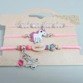 Conjunto de 3 pulseras ajustables de hilo rosa claro con adorno en metal unicornio