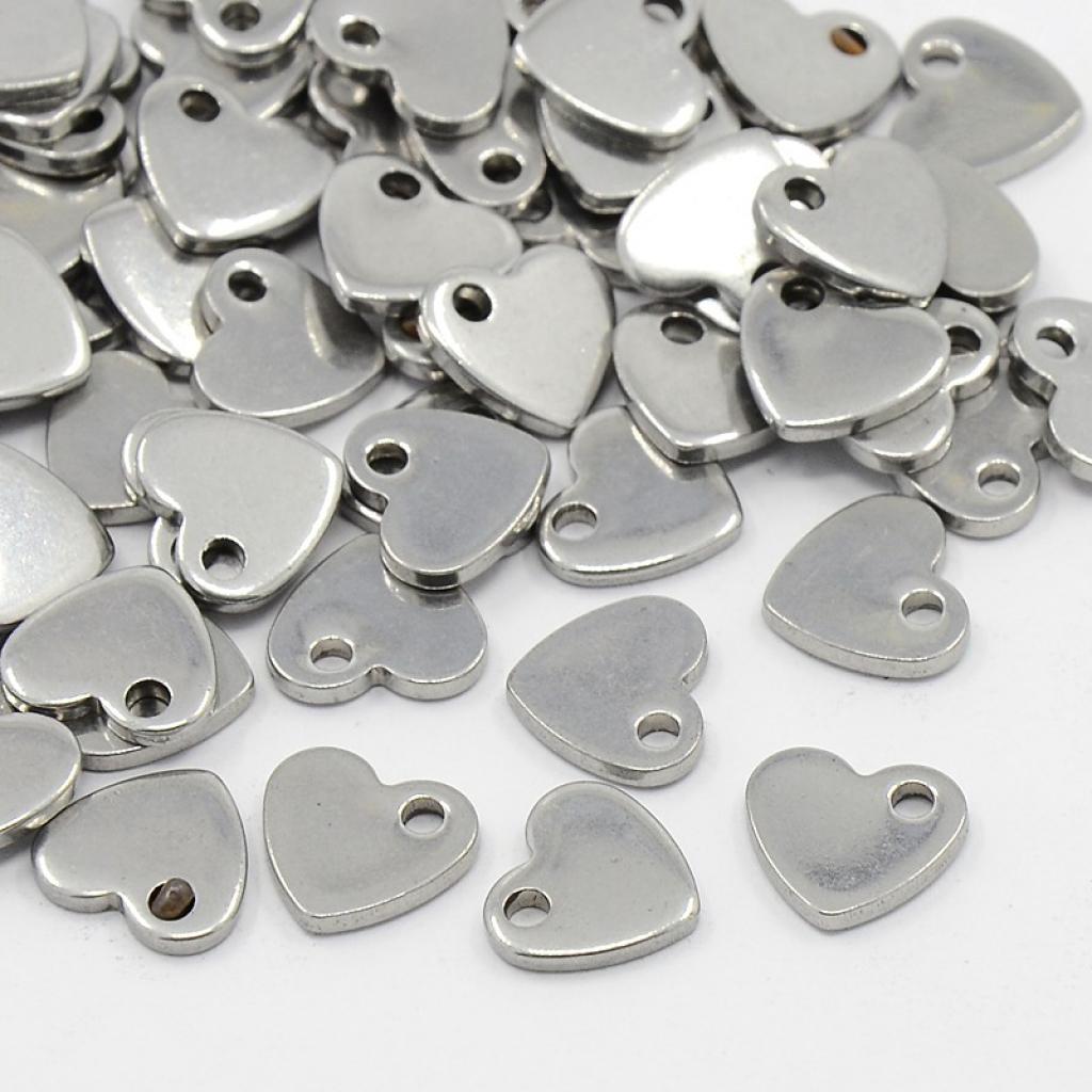Colgante de acero inoxidable corazón 10x9x1,5mm. Agujero 1,5mm