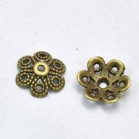 50 Unidades. Cascarilla metálica bronce antiguo de 12mm de diámetro. Agujero 1,5mm