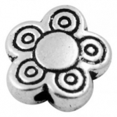 Abalorio metalico flore diam. 10mm. Agujero 1,5mm