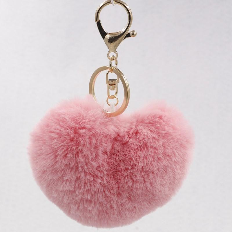 Ponpon llavero corazón rosa claro 7x6 cms. Argolla color plateada